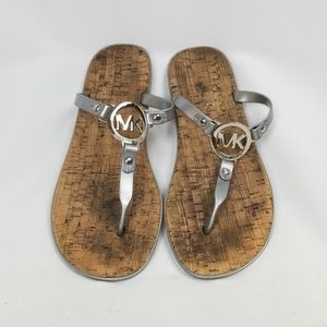 MICHAEL Michael Kors sliver flip flops, size 8